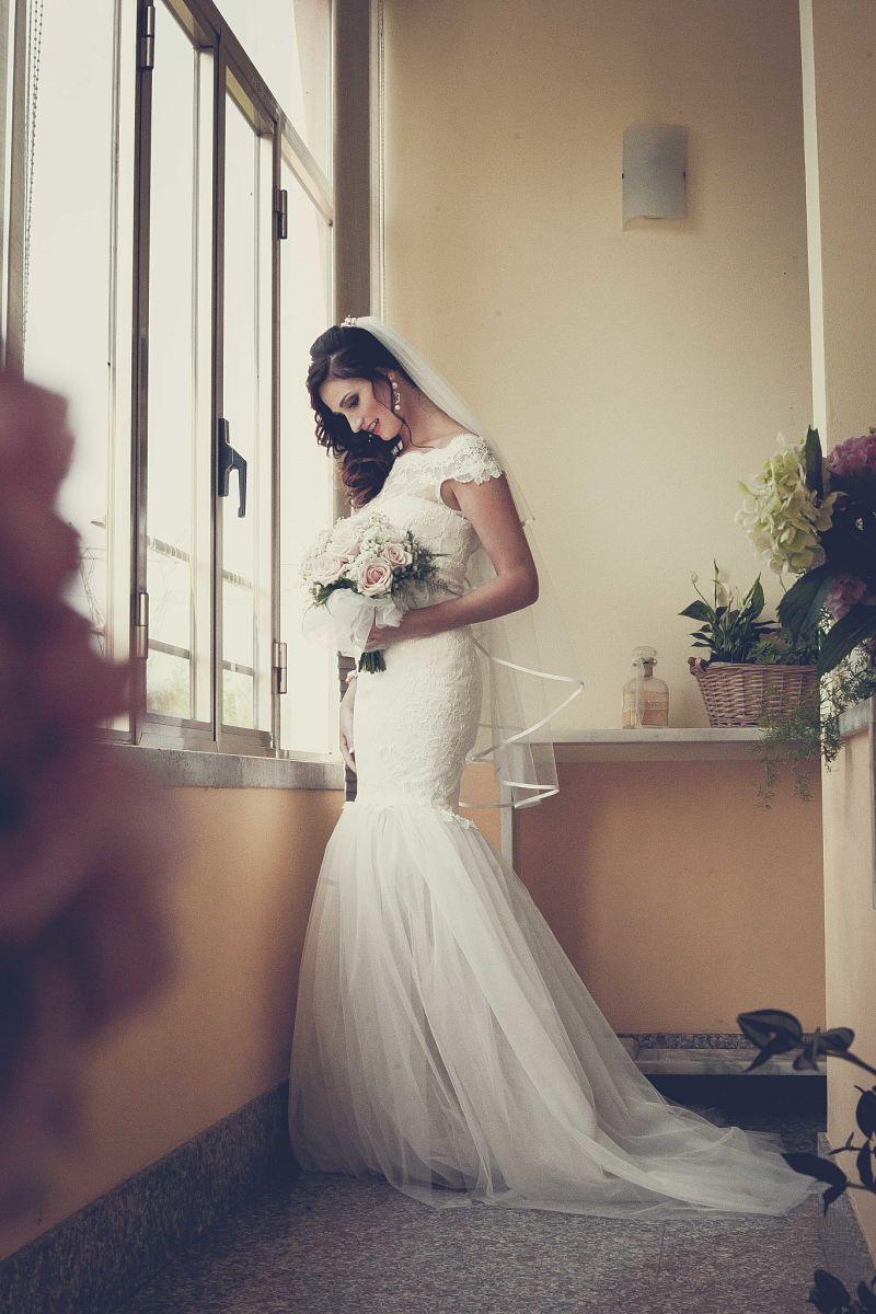 Abito da sposa a sirena in pizzo con scollo a cuore